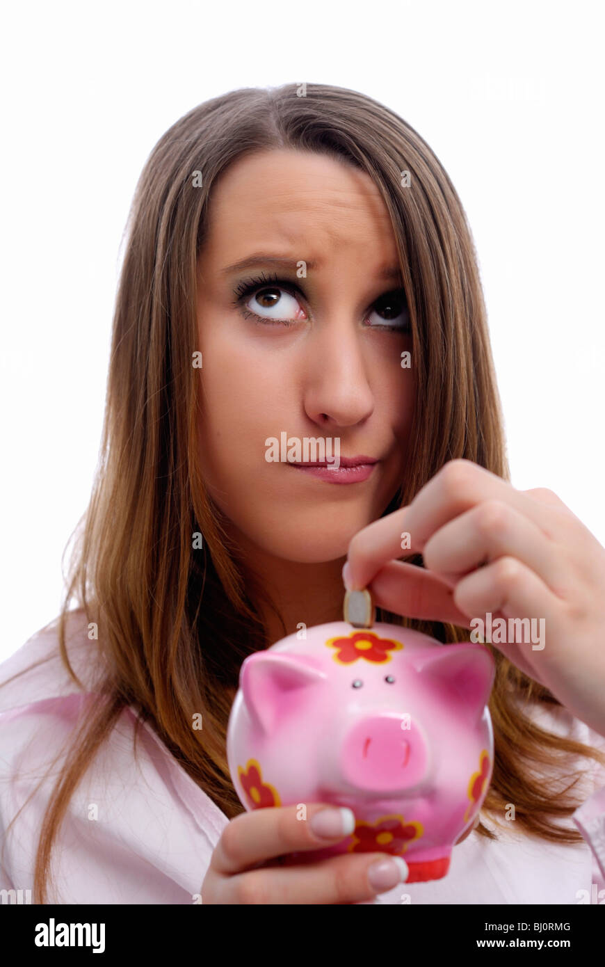 Woman with piggy bank in hand - Stock Image