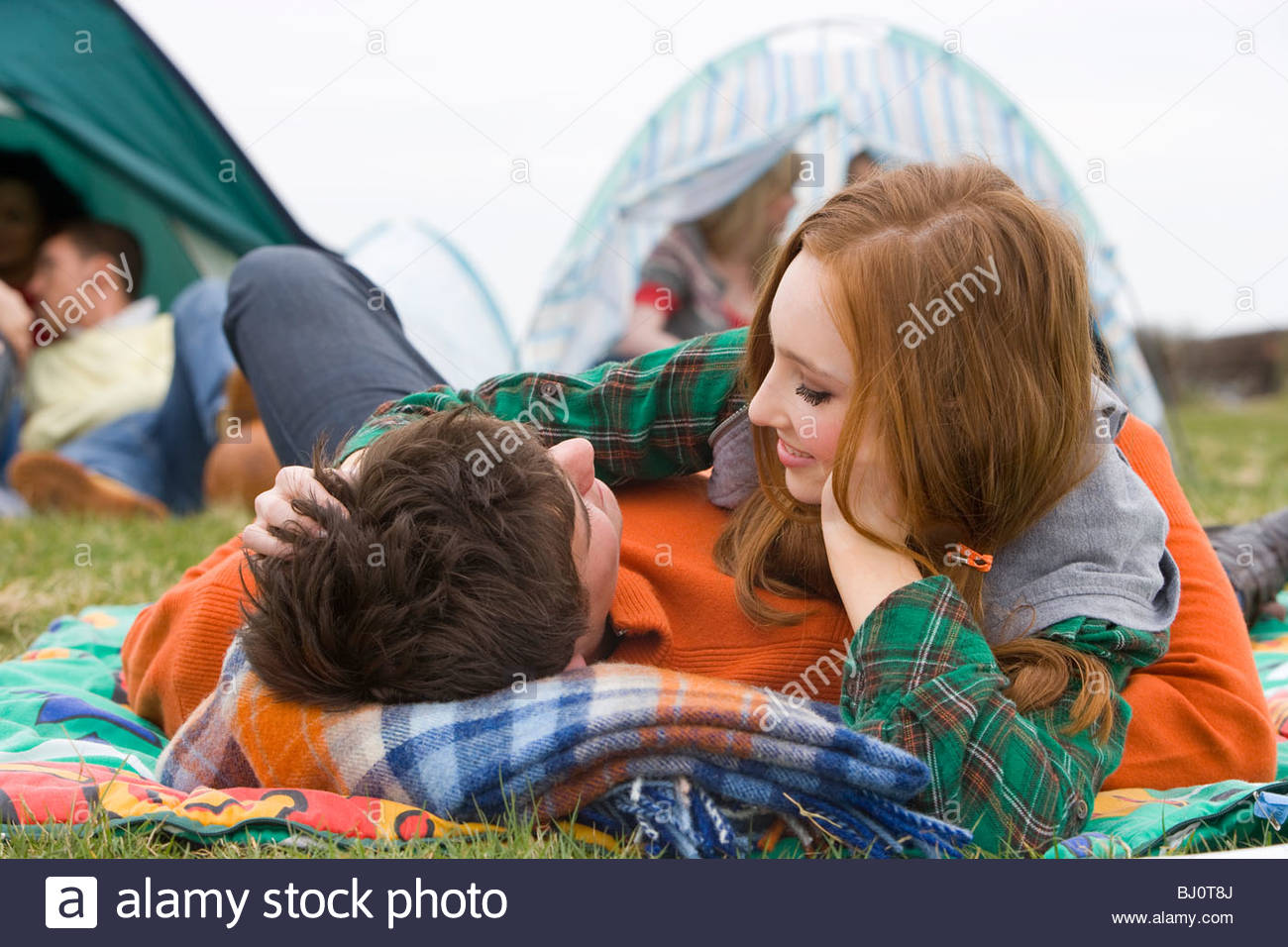 Romantic couple camping and attending outdoor festival - Stock Image