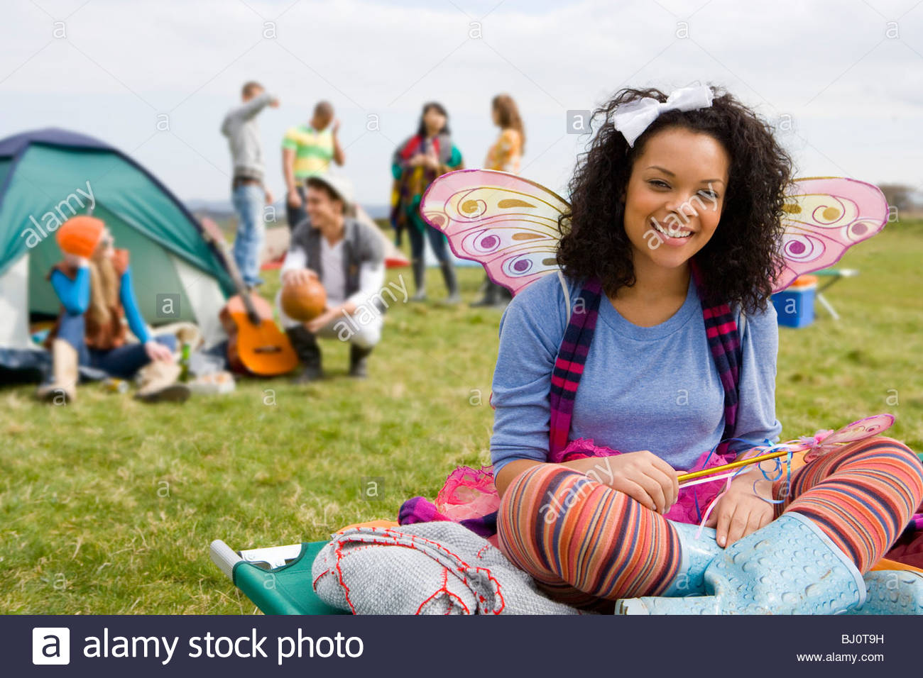 Teenage girl in fairy costume camping and attending outdoor festival - Stock Image