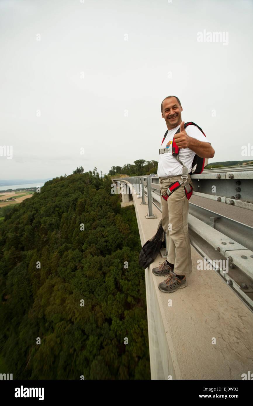 45b3cf24aaf BASE jumper getting ready to jump the high way bridge. Fun but Stock ...
