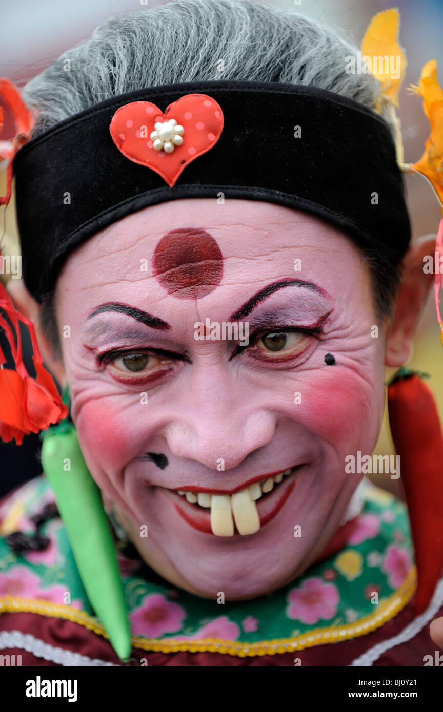 Chinese man playing the clown during Spring Festival performing in Yuxian, Hebei, China. 28-Feb-2010 - Stock Image