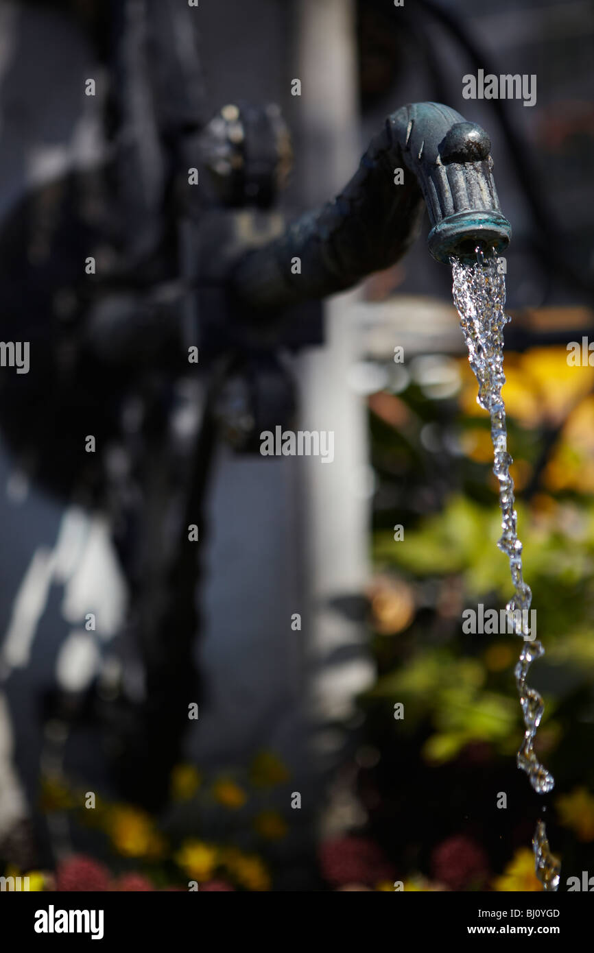 Drinking water tap fountain in Geneva, Switzerland - Stock Image