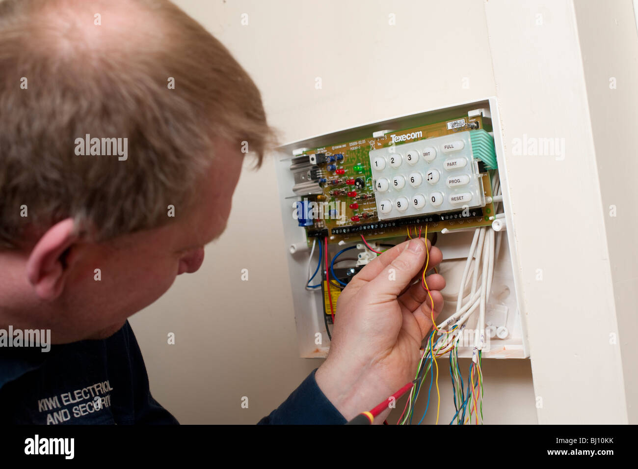 Electrician fitting a burglar alarm in a Shropshire home Stock Photo ...