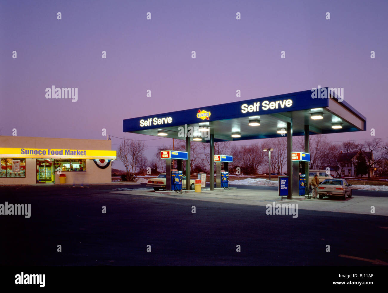 Dusk view of a gasoline station and convenience store Stock Photo