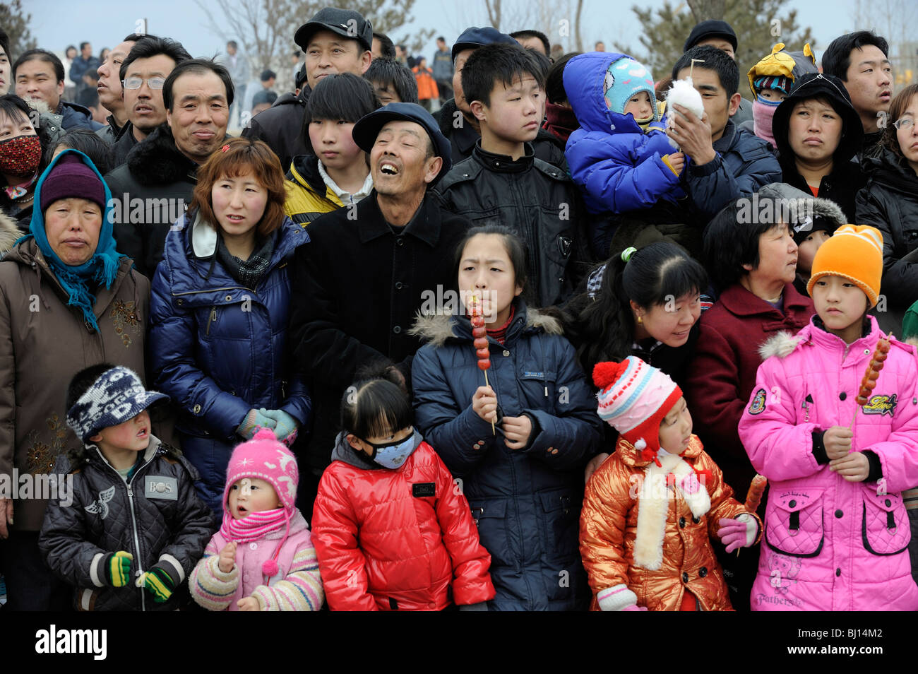 People look on Spring Festival performing in Yuxian, Hebei province, China. 28-Feb-2010 - Stock Image