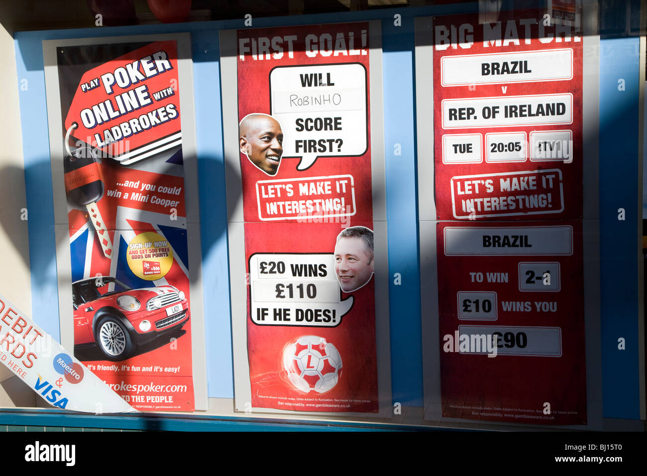Betting shop window display football bets UK - Stock Image