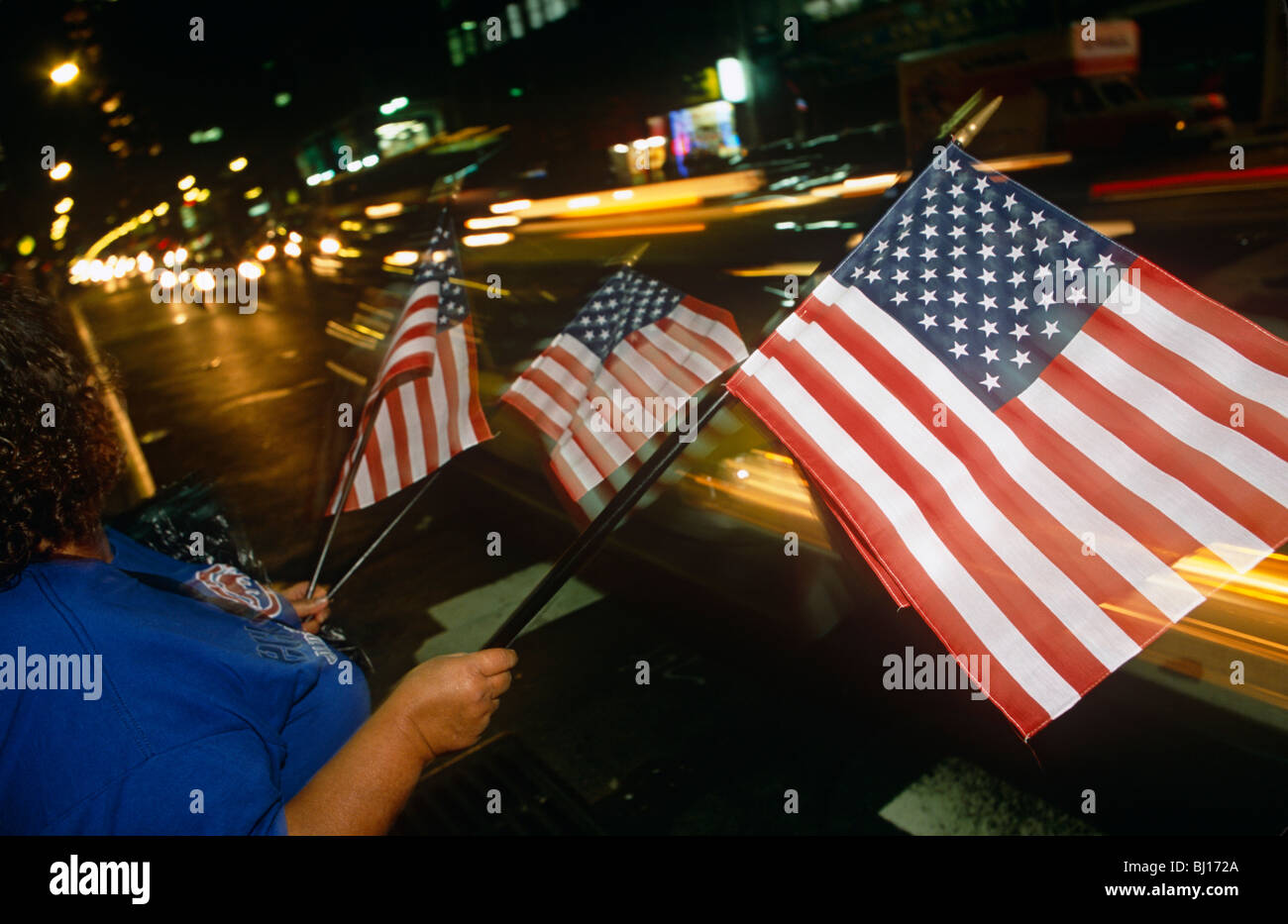 American flags are on sale at night in the streets of Manhattan, only days after the attacks on New York's twin - Stock Image