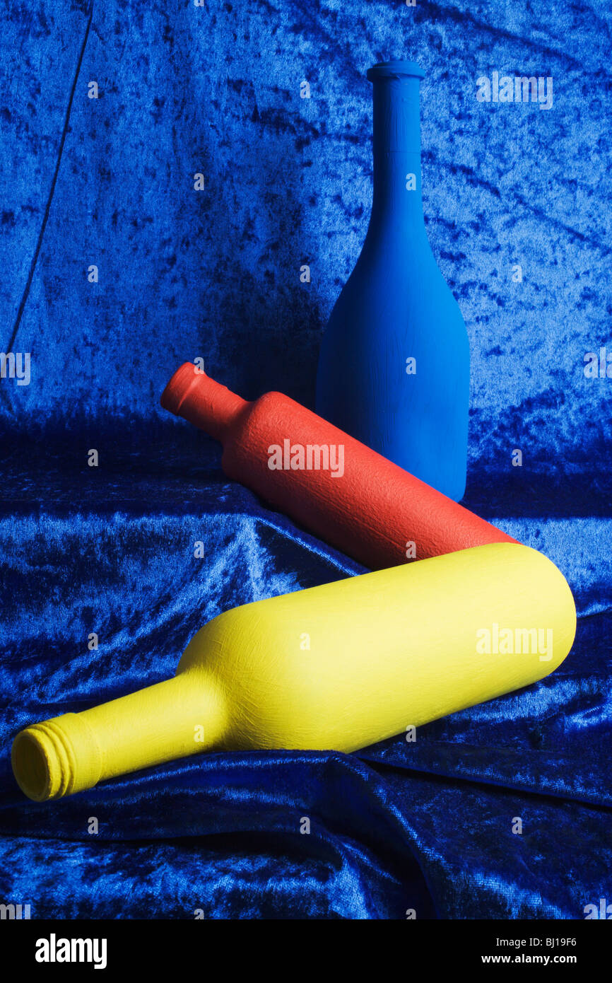 Bottles in primary colours. - Stock Image