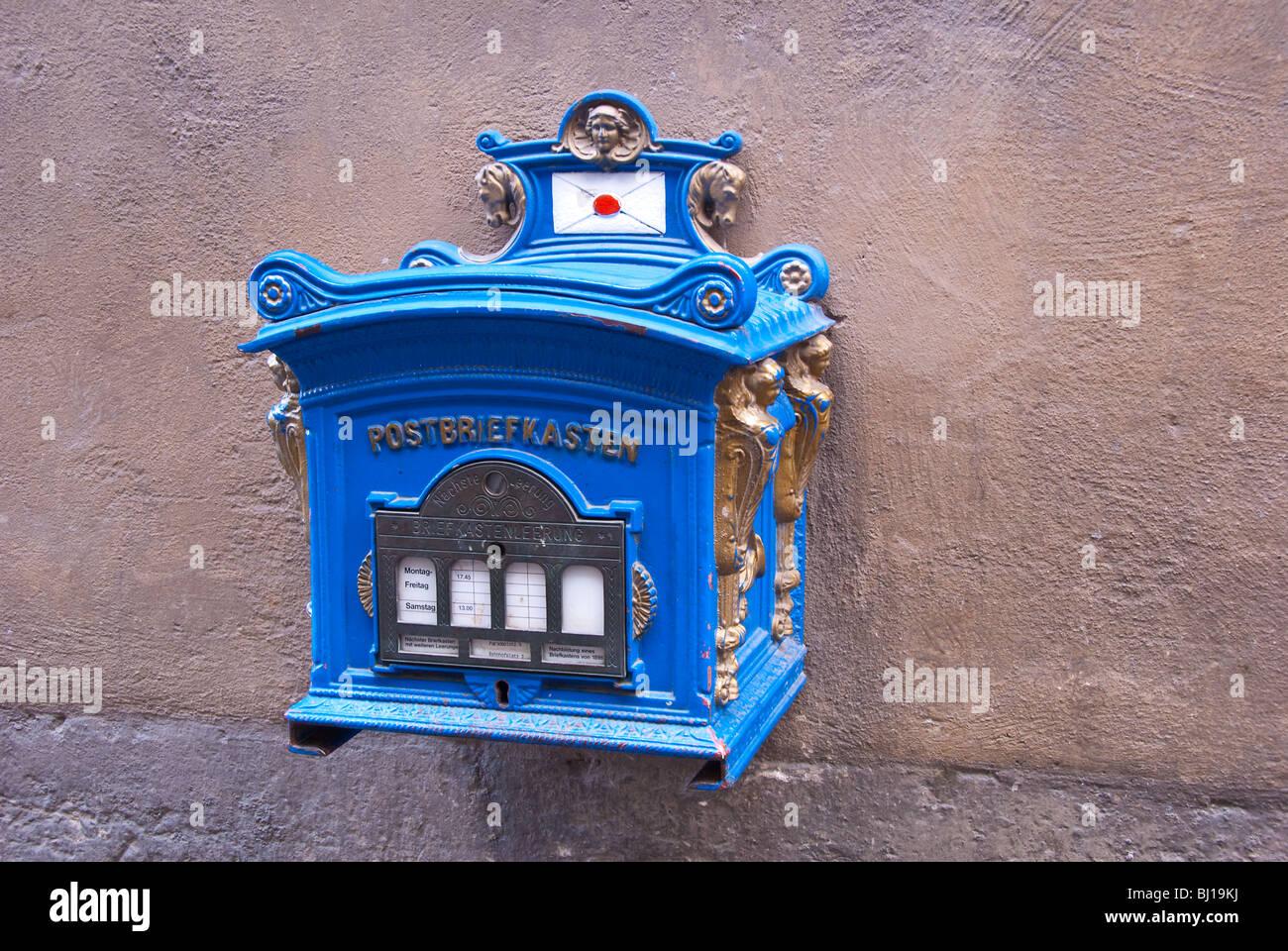 Postal mail box on wall in Wurzburg, Bavaria, Germany - Stock Image