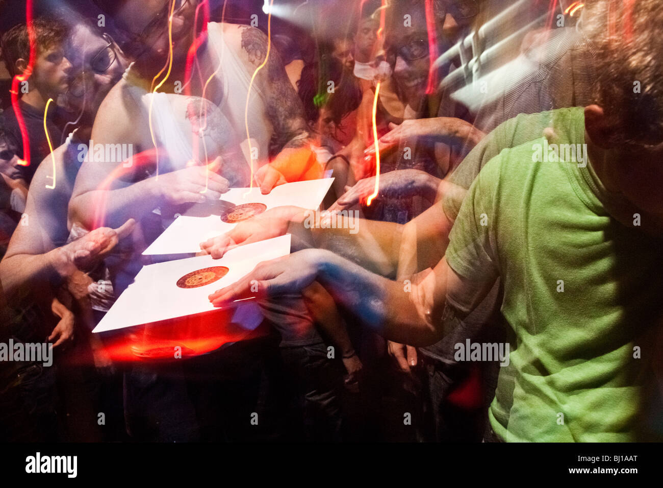Partyers pretending to spin a record at Zizek Electro, Cumbia and Reggaeton party at Niceto Club, Buenos Aires - Stock Image