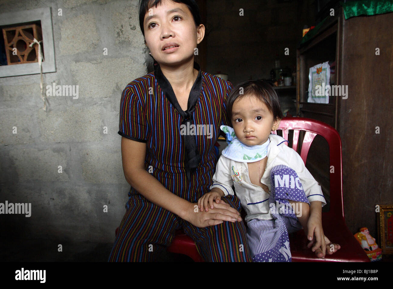 Mother with her son, Hue, Vietnam Stock Photo