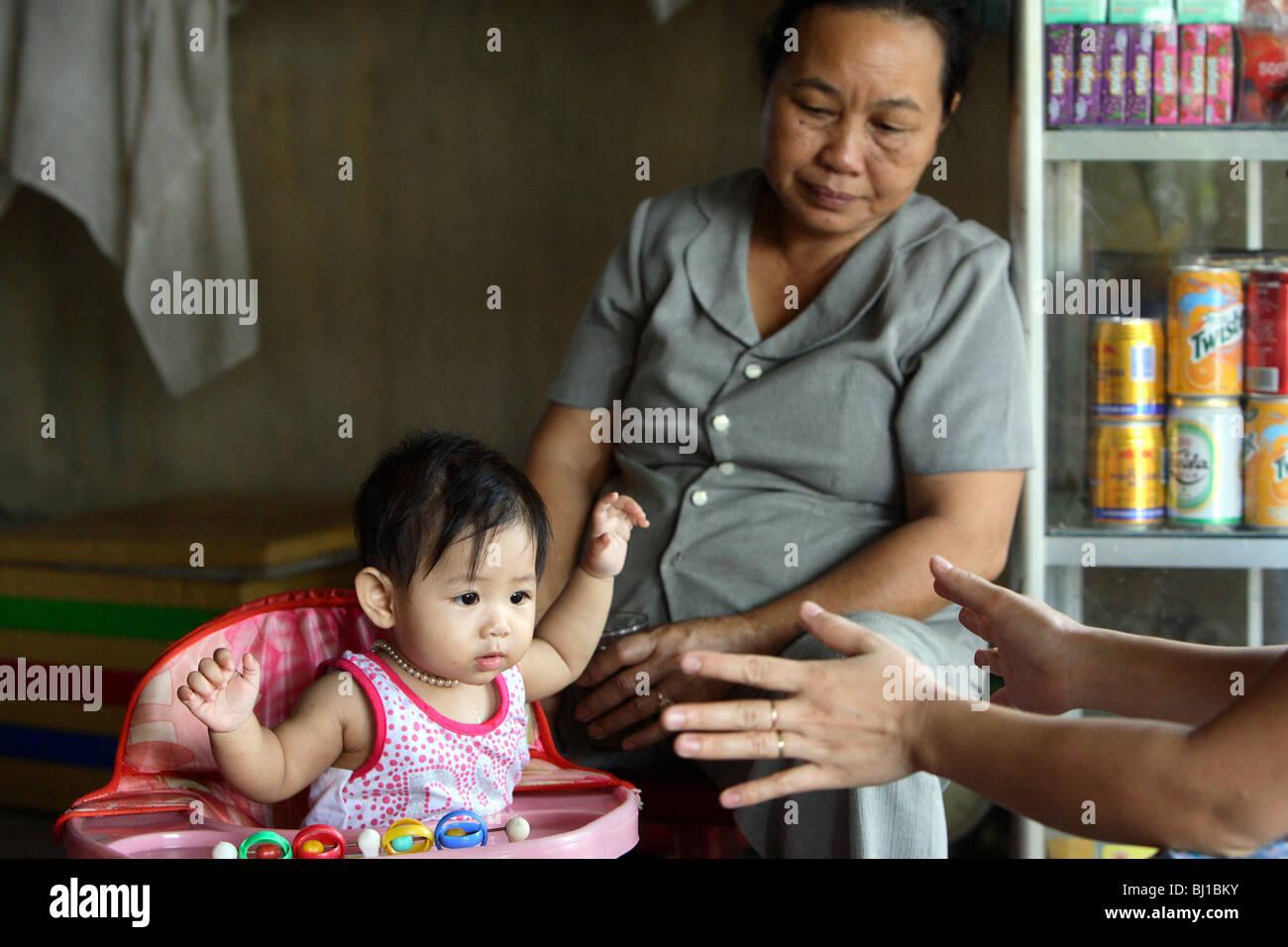 Grandmother with her grandson, Hue, Vietnam Stock Photo