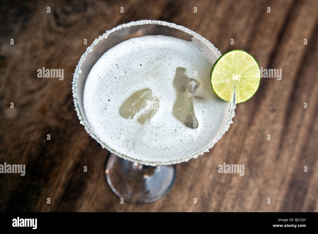 traditional icy Mexican margarita drink with lime slice & salt crusted glass rim Oaxaca City Mexico - Stock Image