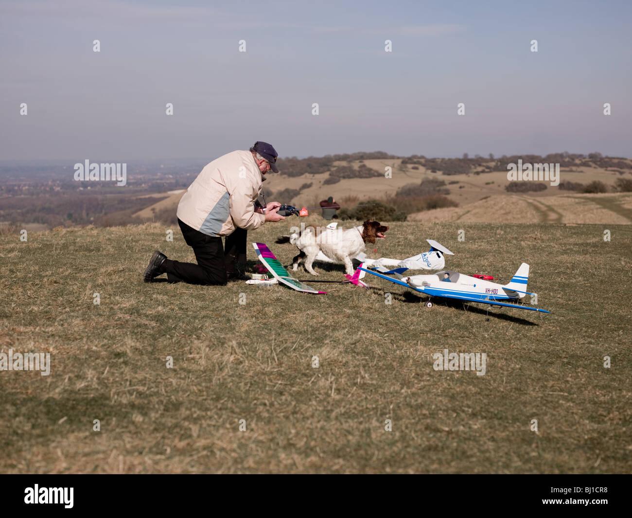 man iwth model planes. - Stock Image