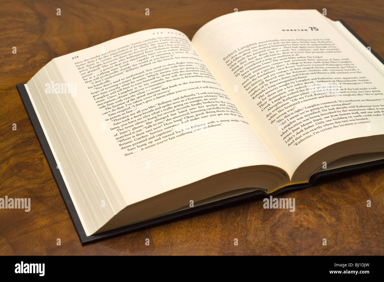 Book open on a table - Stock Image