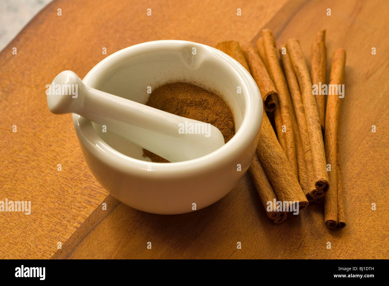 Cinnamon, ground and whole quills Stock Photo
