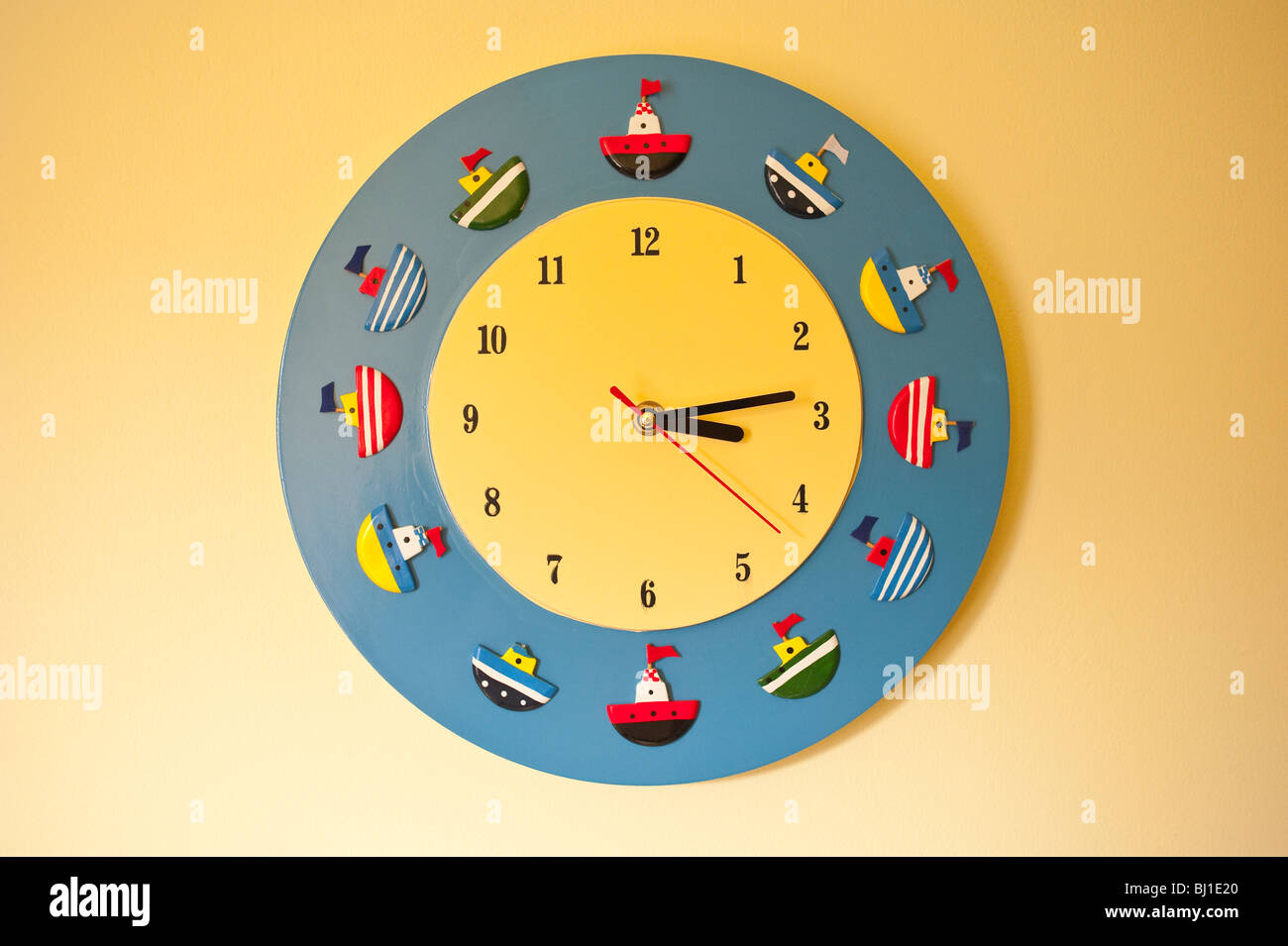 A childs nautical scene wall clock - Stock Image