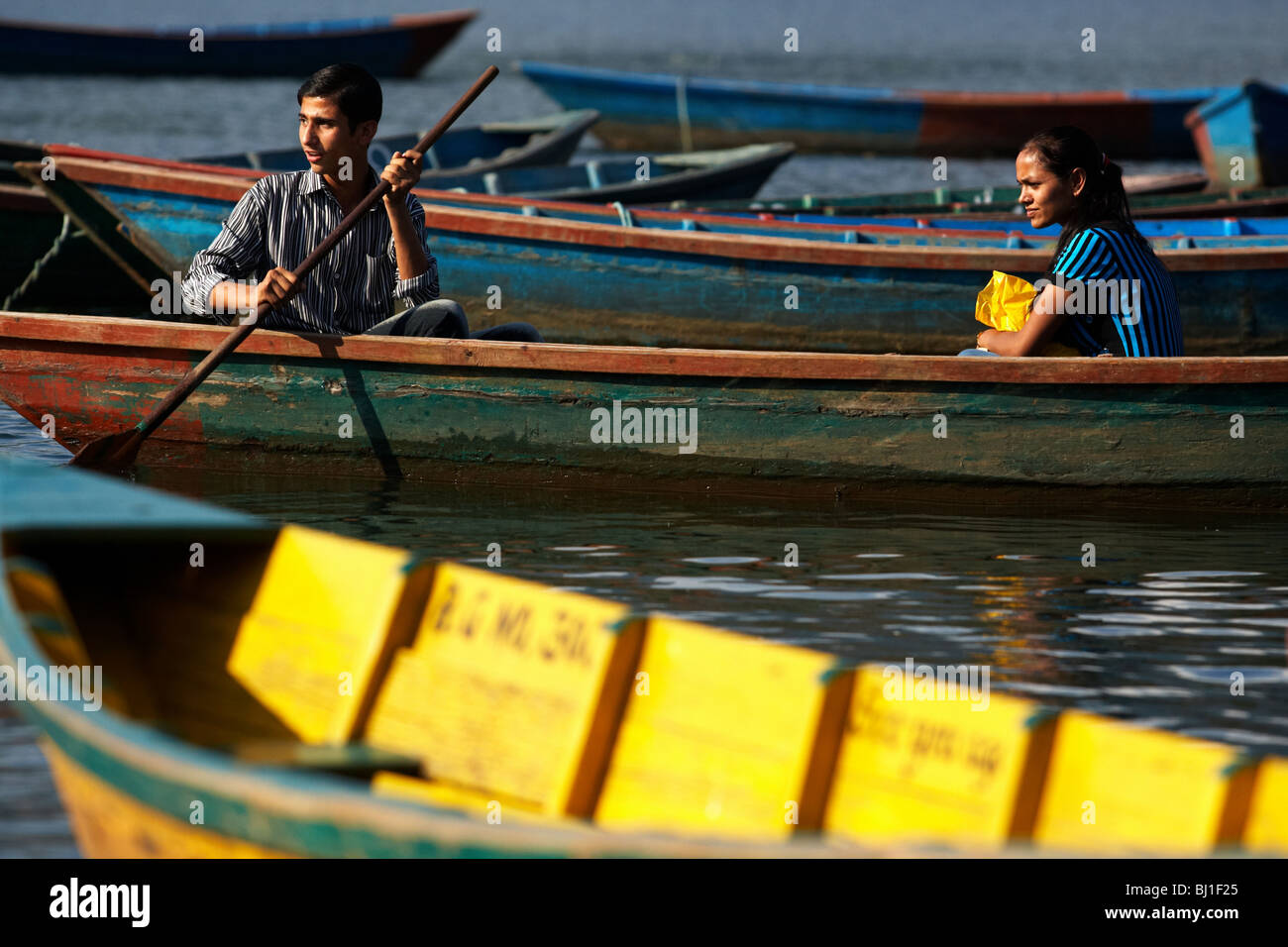 Young couple in a canoe on Pewha Lake in Pokhara, Nepal on Monday October 26, 2009. - Stock Image