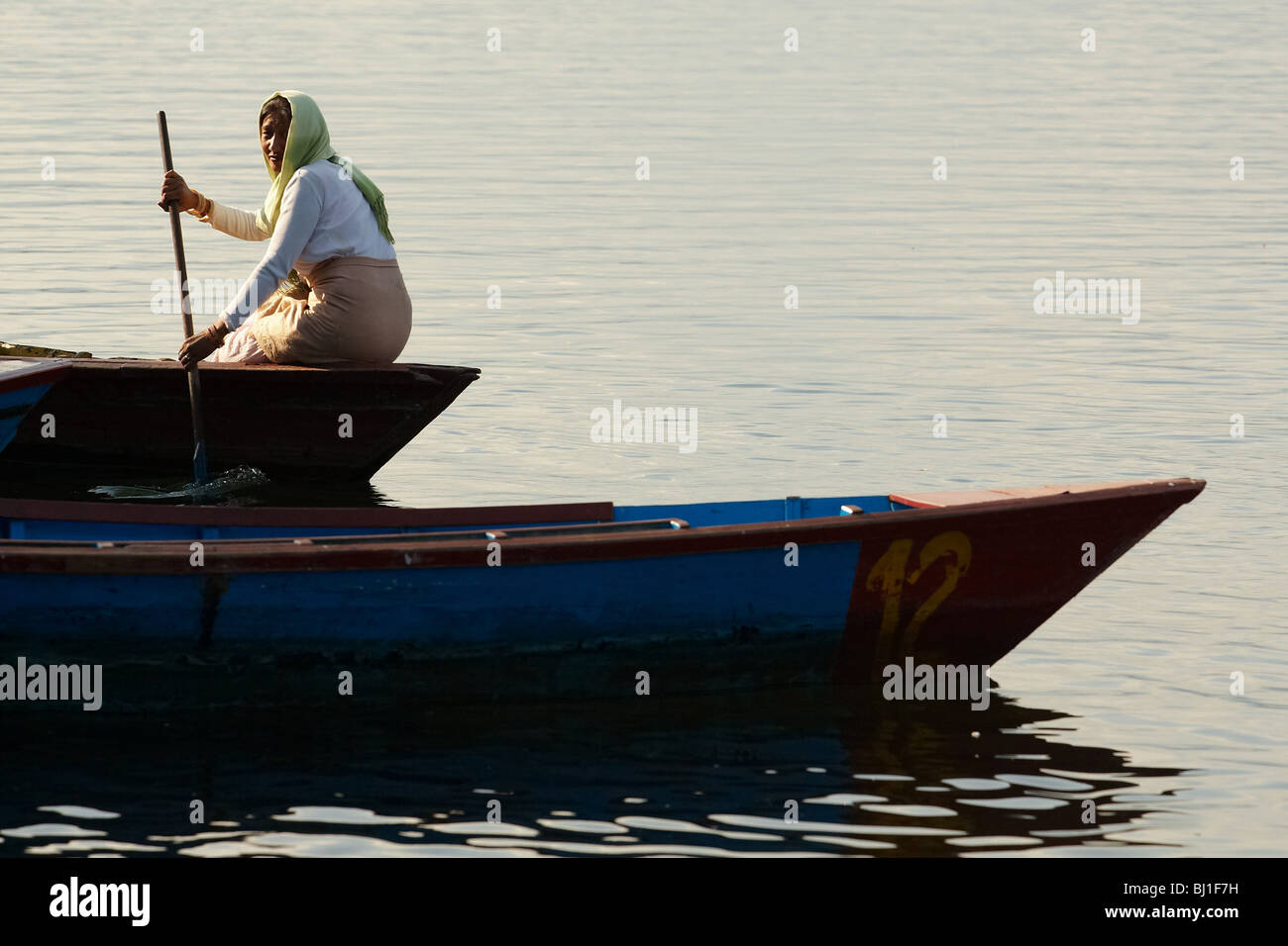 Woman sitting in a canoe on Pewha Lake in Pokhara, Nepal on Monday October 26, 2009. - Stock Image