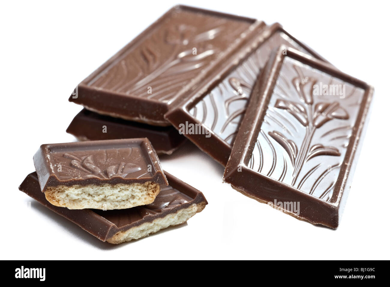 Stack of Belgian embossed pattern milk chocolate biscuits - Stock Image