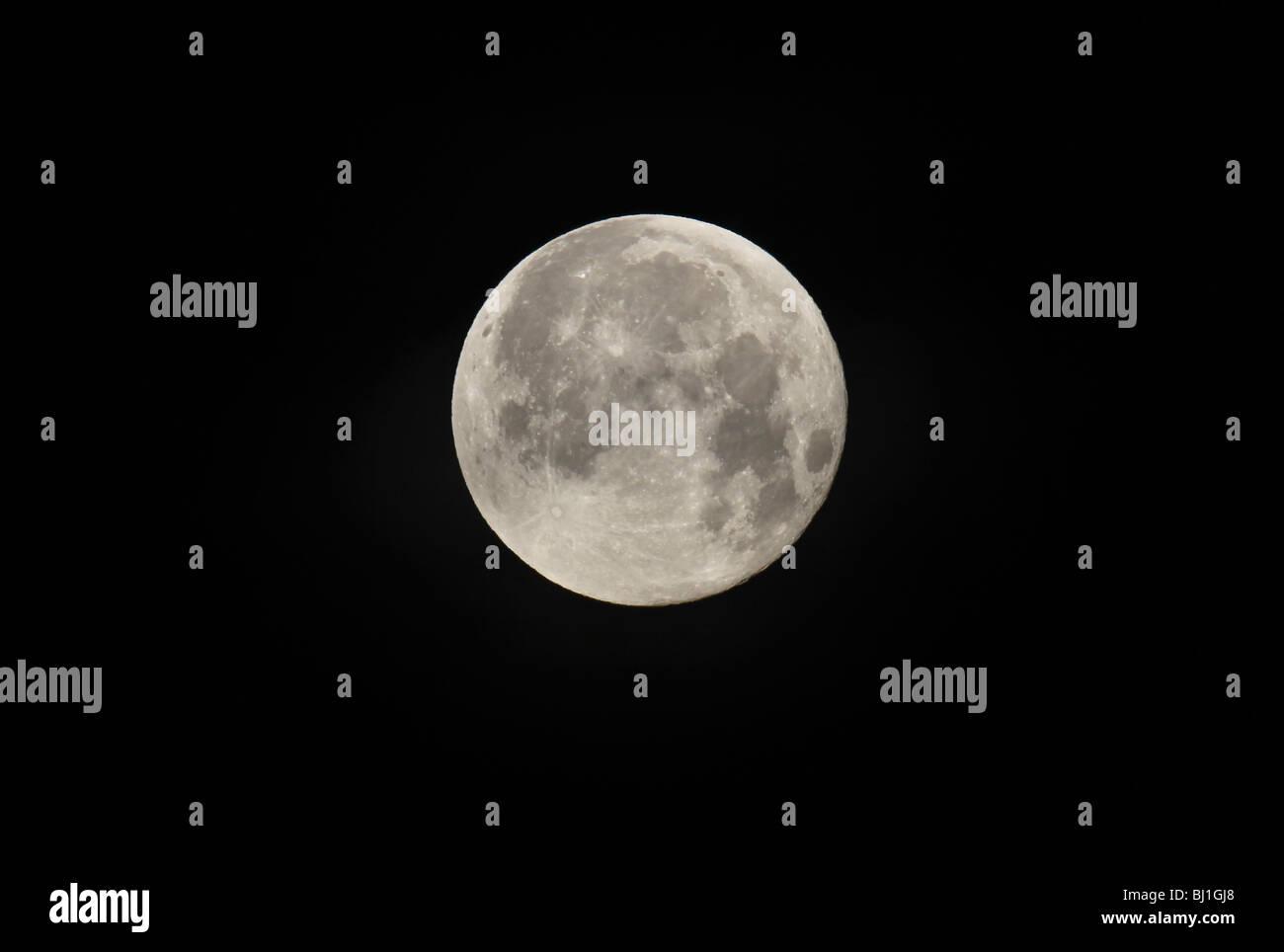Full moon in closeup at black night - Stock Image