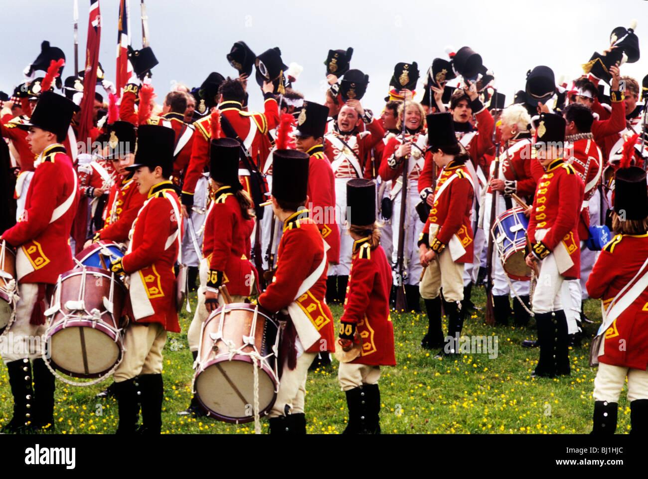 Historical re-enactment, British English redcoats 1815 military history uniform uniforms dress costume costumes - Stock Image