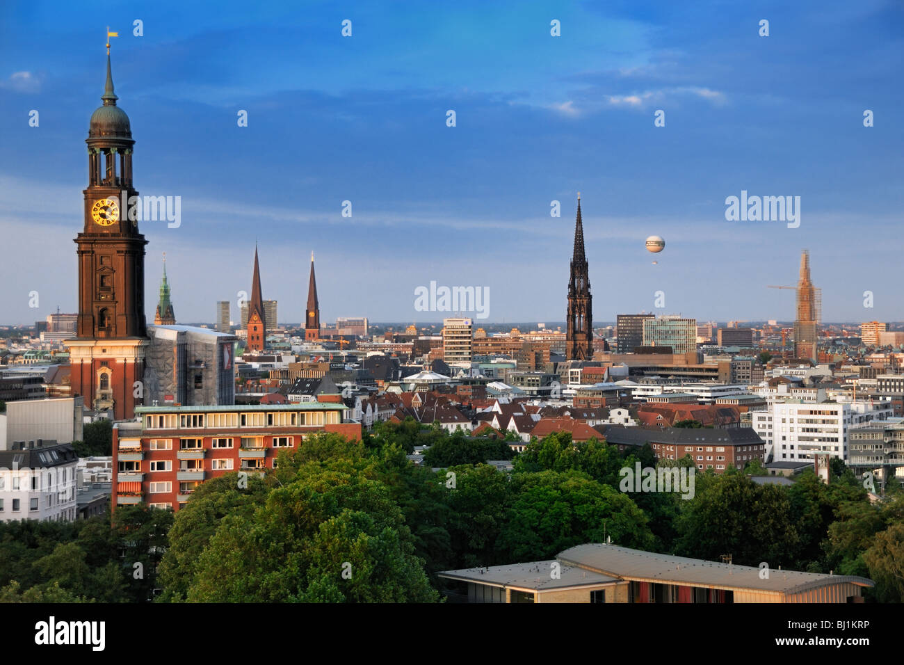 Evening view from the tower-lounge in the Hotel Hafen towards the St. Michaelis Churche and Hamburg, Germany. - Stock Image