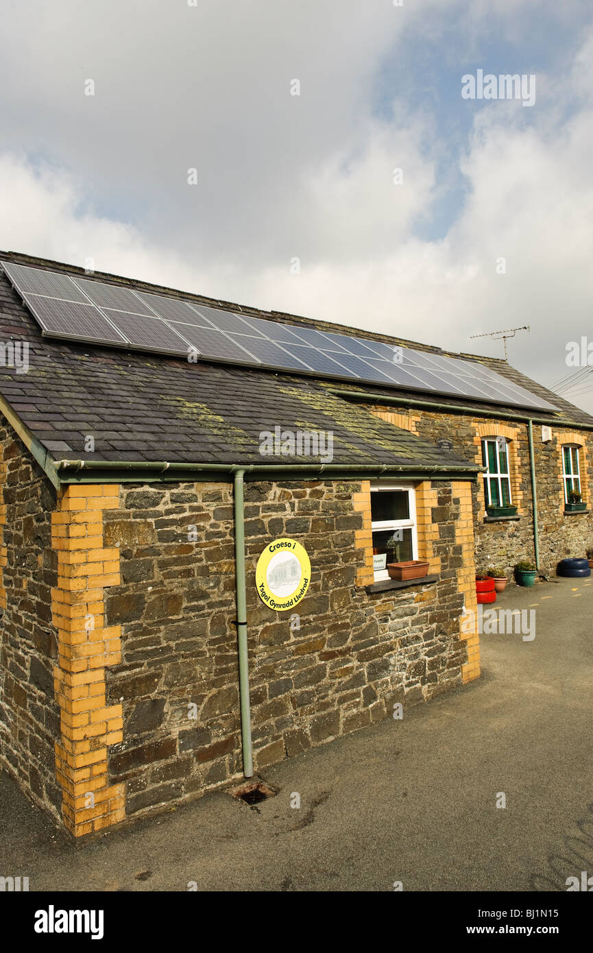 Solar panels on the roof of Lledrod primary school, rural Ceredigion, west wales, with support and finance from - Stock Image