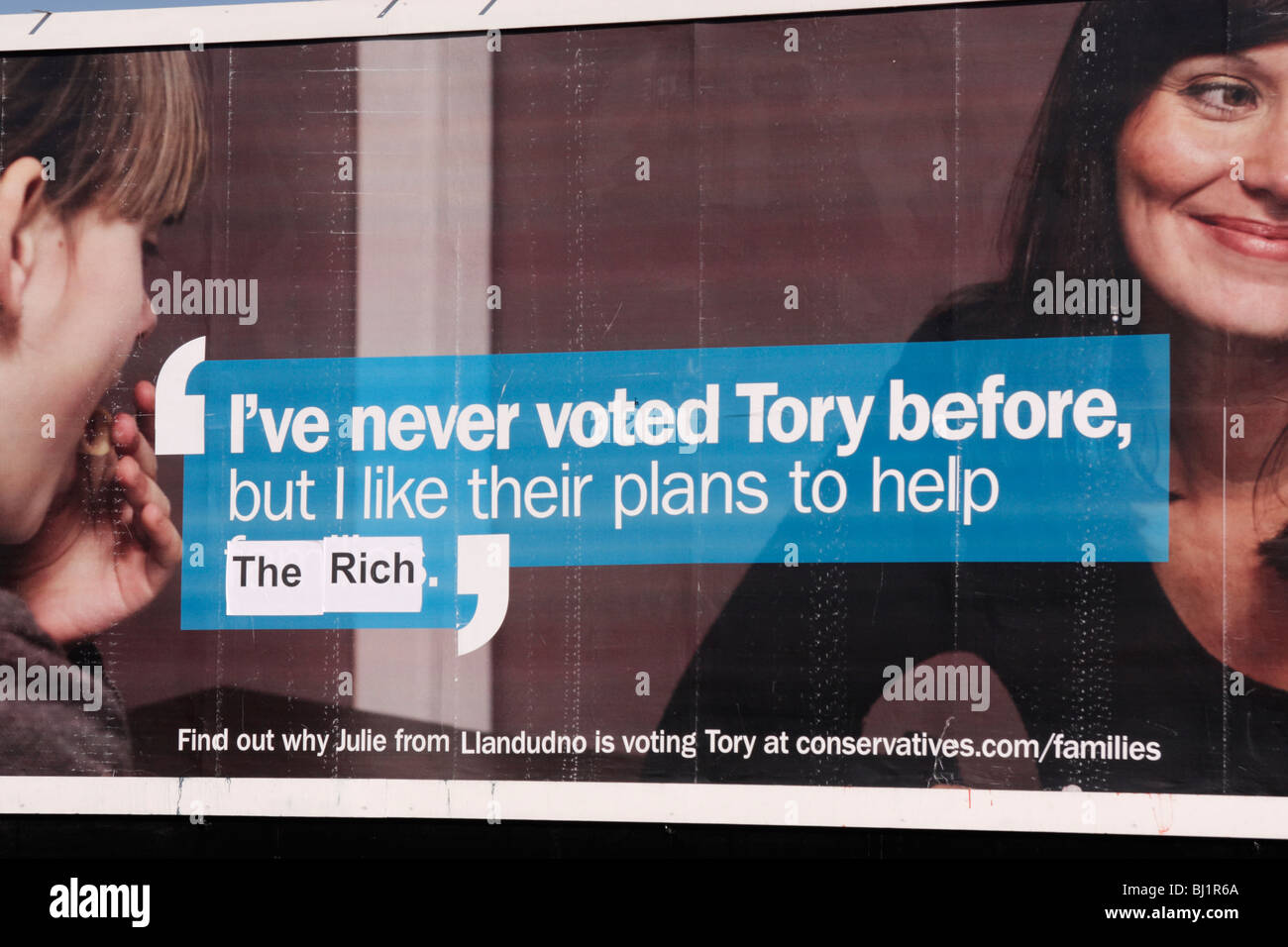 I've never voted Tory before but I like their plans to help families defaced to read 'help the rich' - Stock Image