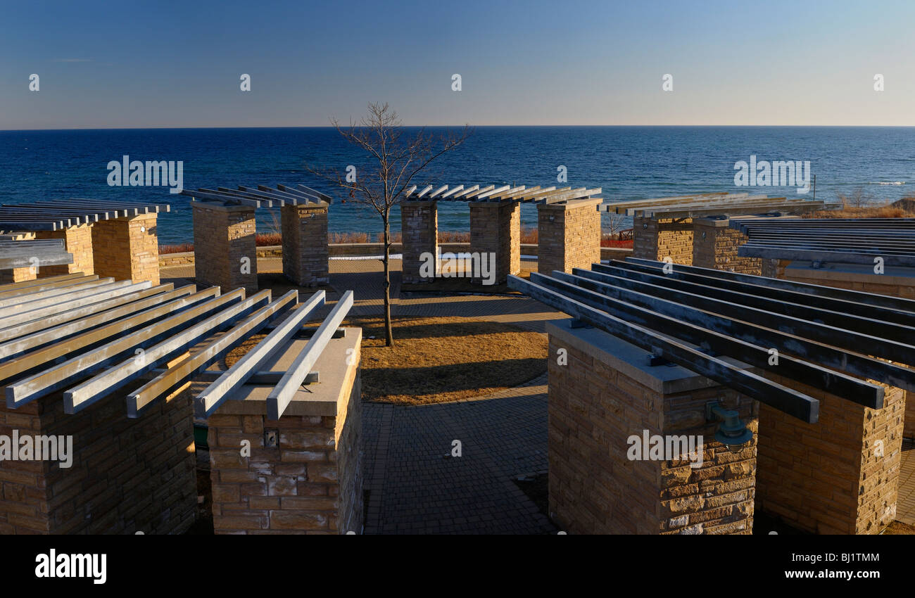 Commemorative abstract stonehenge at the old Ajax water treatment plant site on Lake Ontario in winter - Stock Image