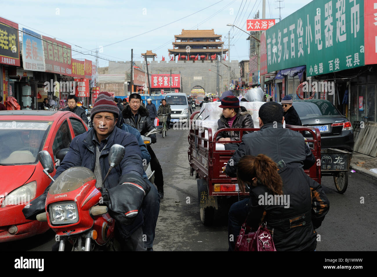 People in the street of Yuxian, Hebei province, a typical town in Western China. 02-Mar-2010 - Stock Image