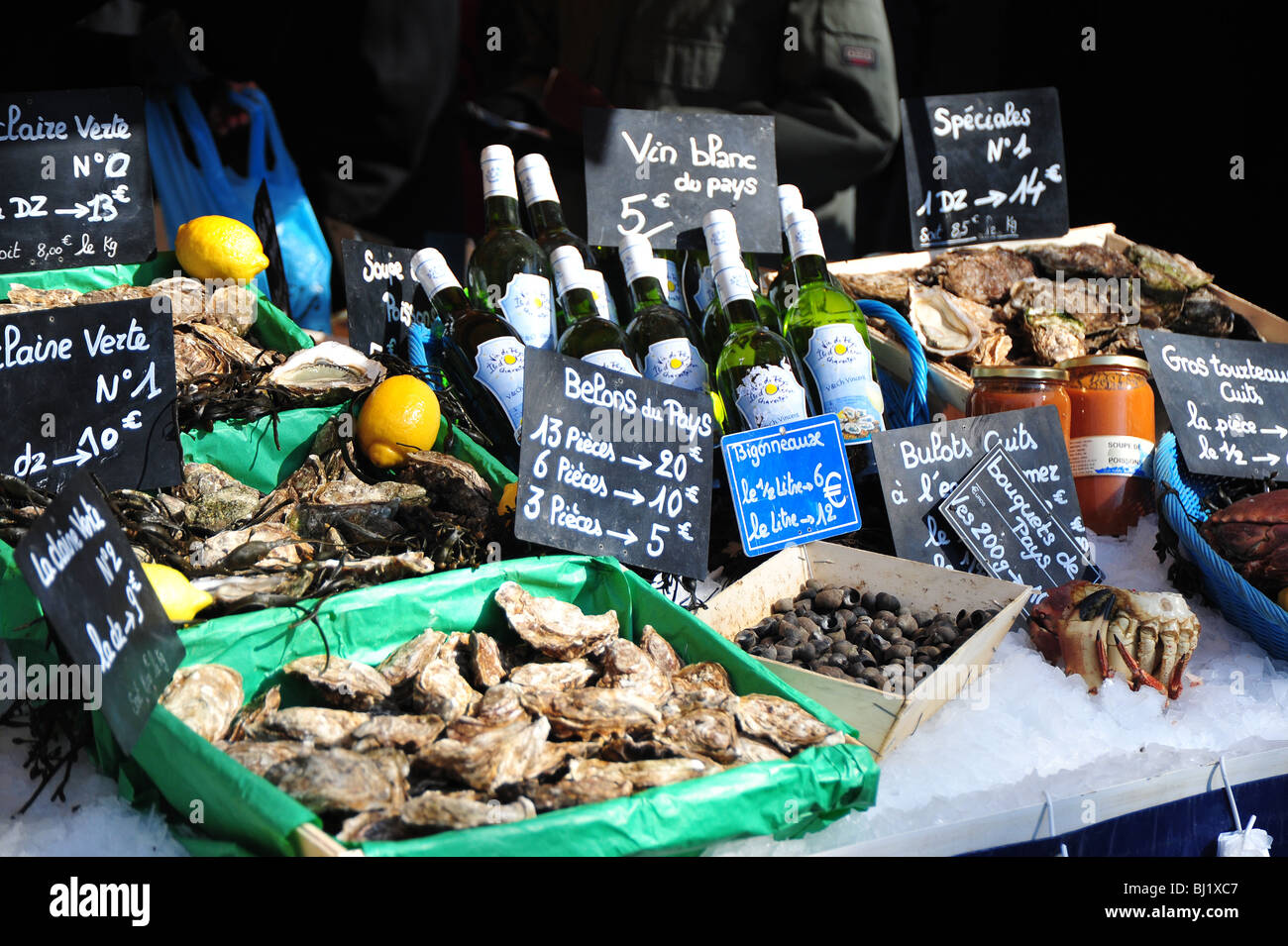 Oysters and wime on display  at a seafood stall at Paris market,  Boulevard Richard Lenoir at Bastille, Paris - Stock Image
