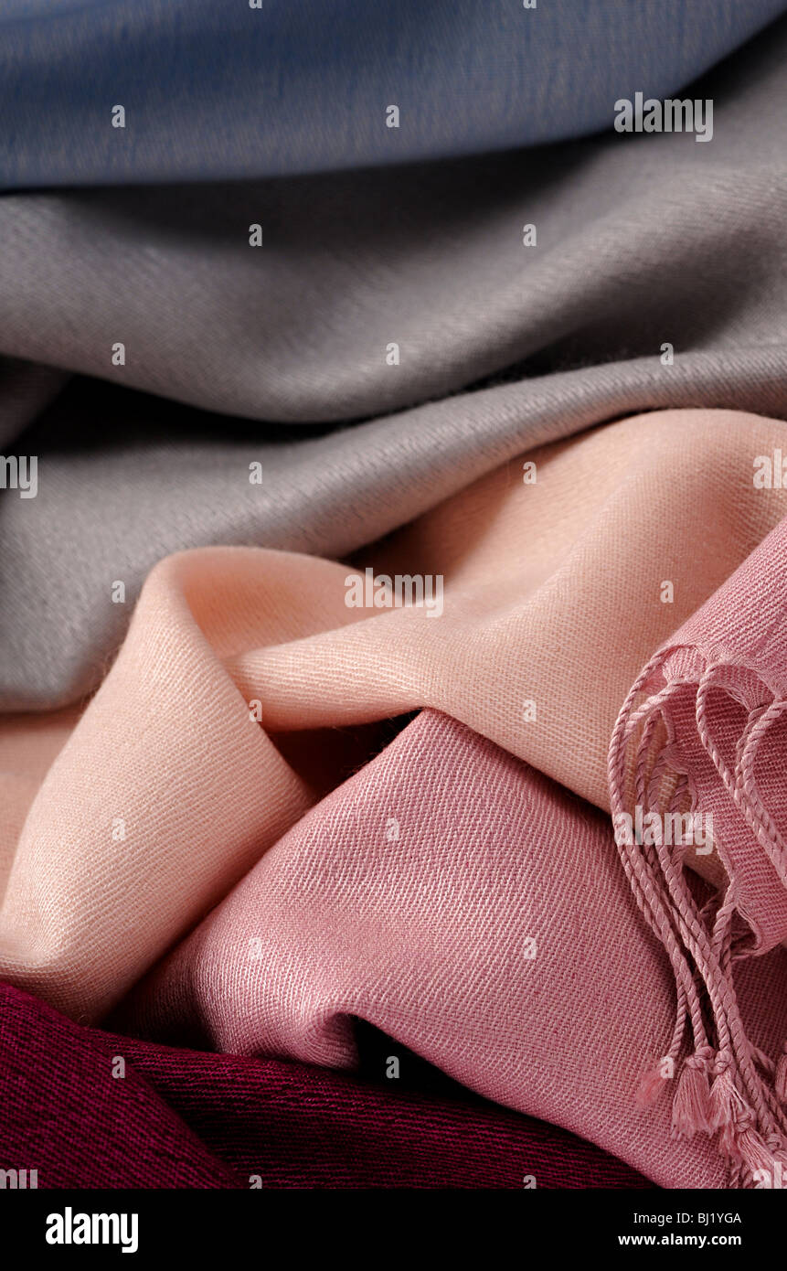 collection of pale colored cashmere Pashminas folded - Stock Image