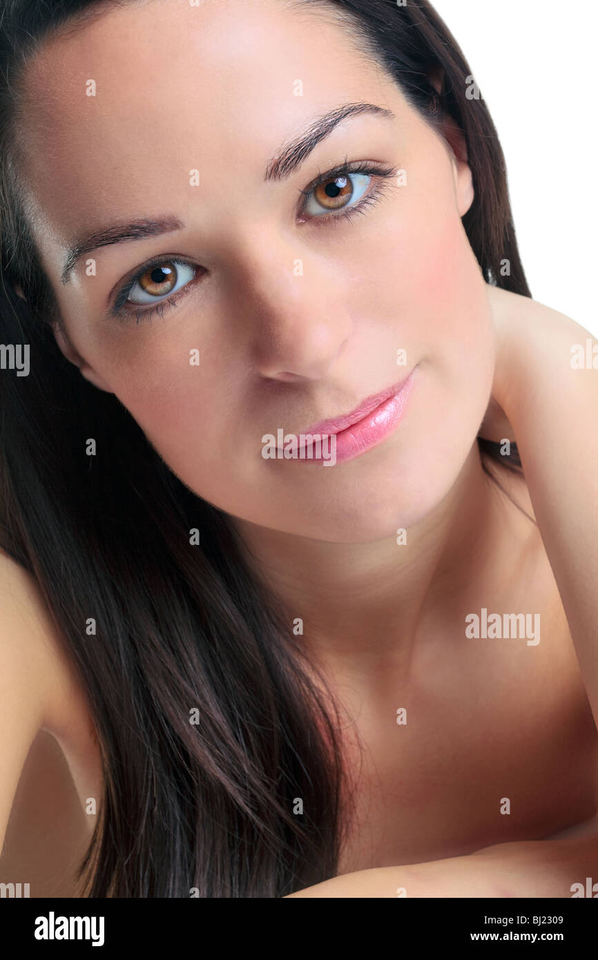 Close up portrait of an attractive brunette woman in her late twenties. - Stock Image