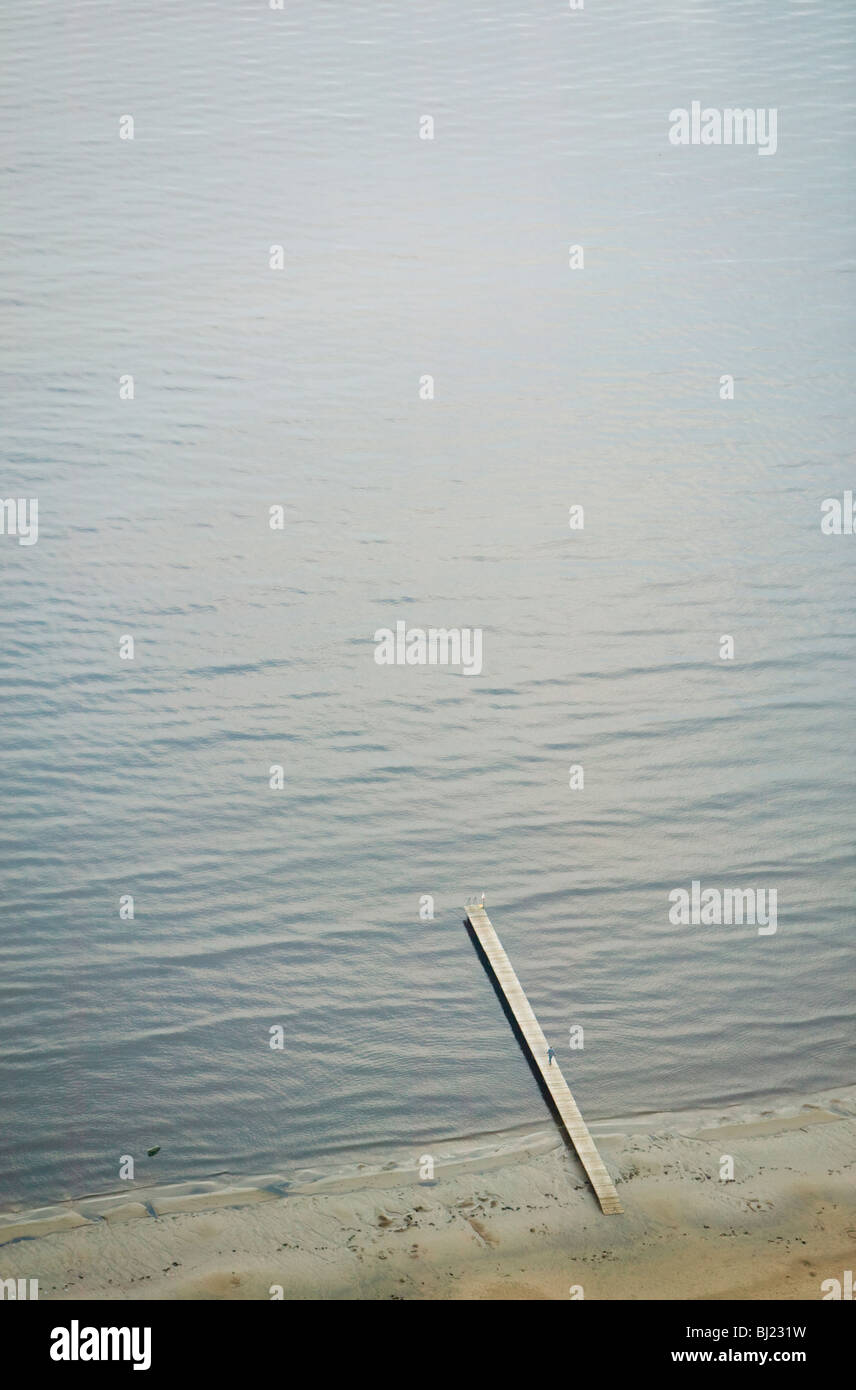 A jetty  straight  in to the ocean - Stock Image