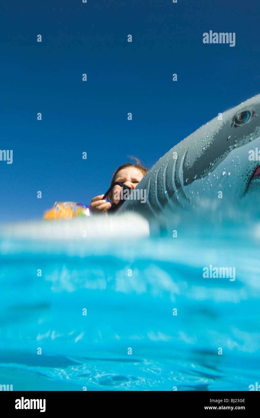 Girl bathing in turquoise water, Egypt. - Stock Image