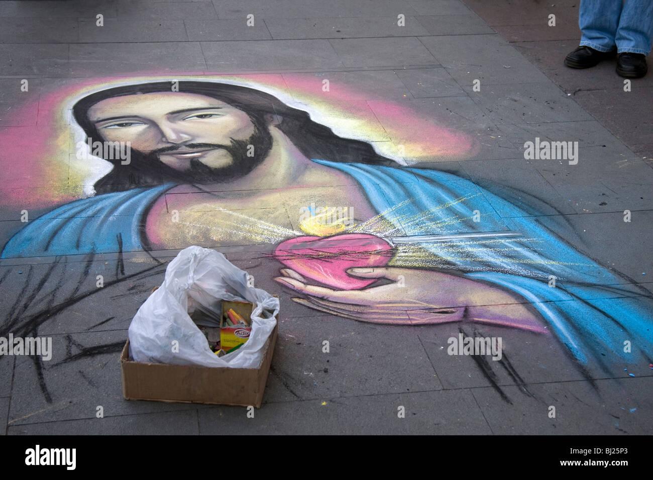 Sidewalk chalk drawing of Jesus, Plaza de Armas, Santiago, Chile, South America - Stock Image