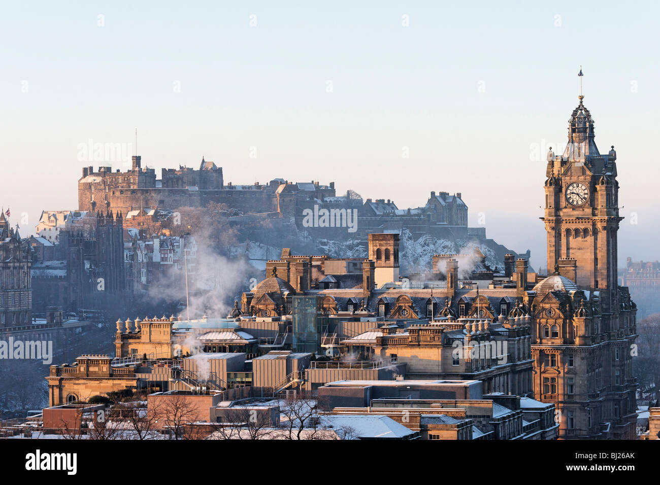 Edinburgh Castle and the clocktower of the Balmoral Hotel, Edinburgh, Scotland, UK. - Stock Image