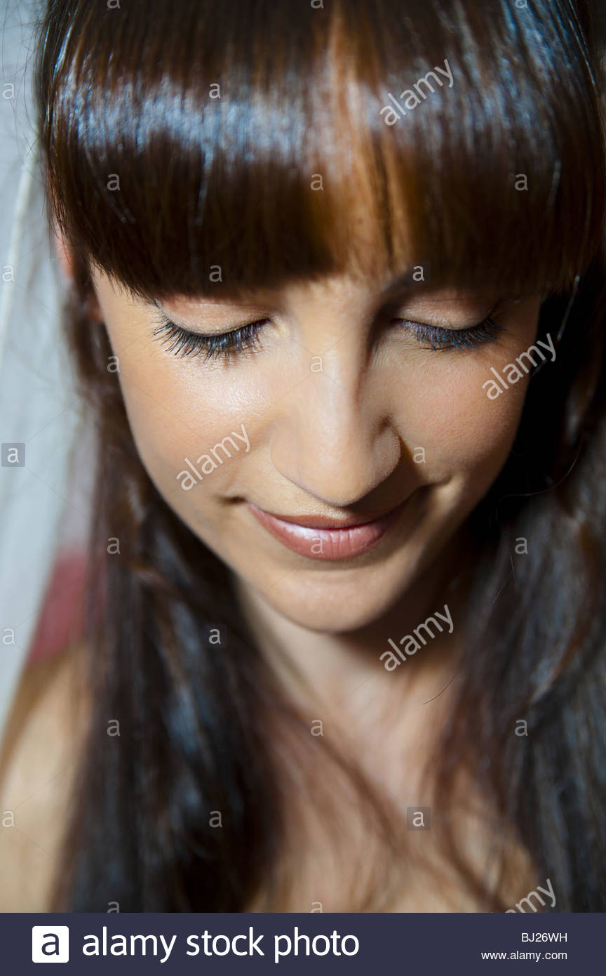 Young woman portrait with fringe - Stock Image