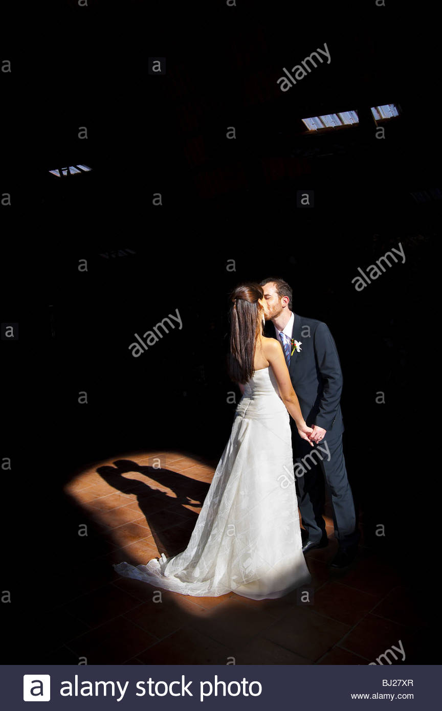 Bride and groom kissing - Stock Image