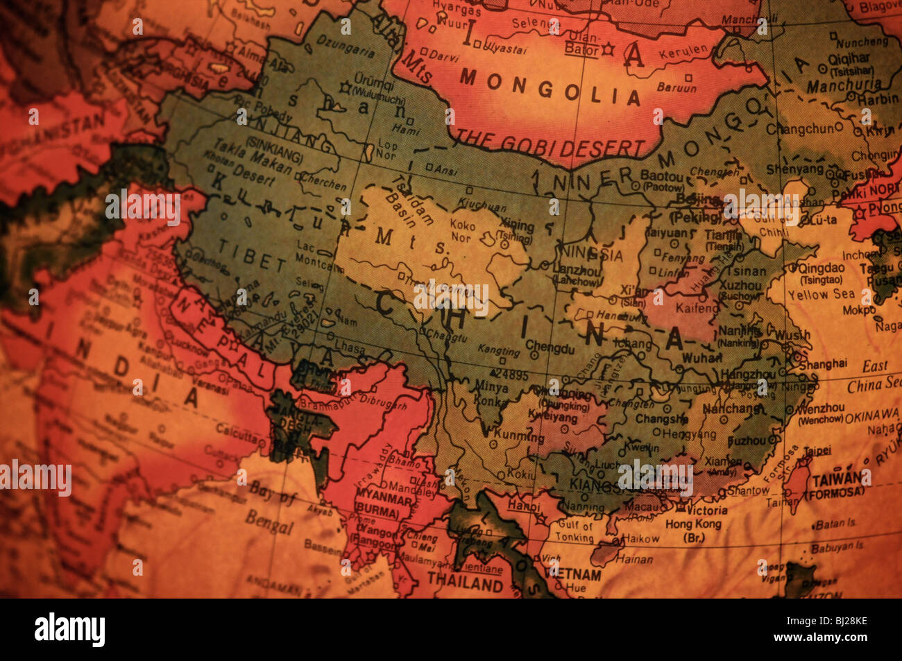 A detail photo of the world as depicted on an antique globe. Focusing on China. - Stock Image