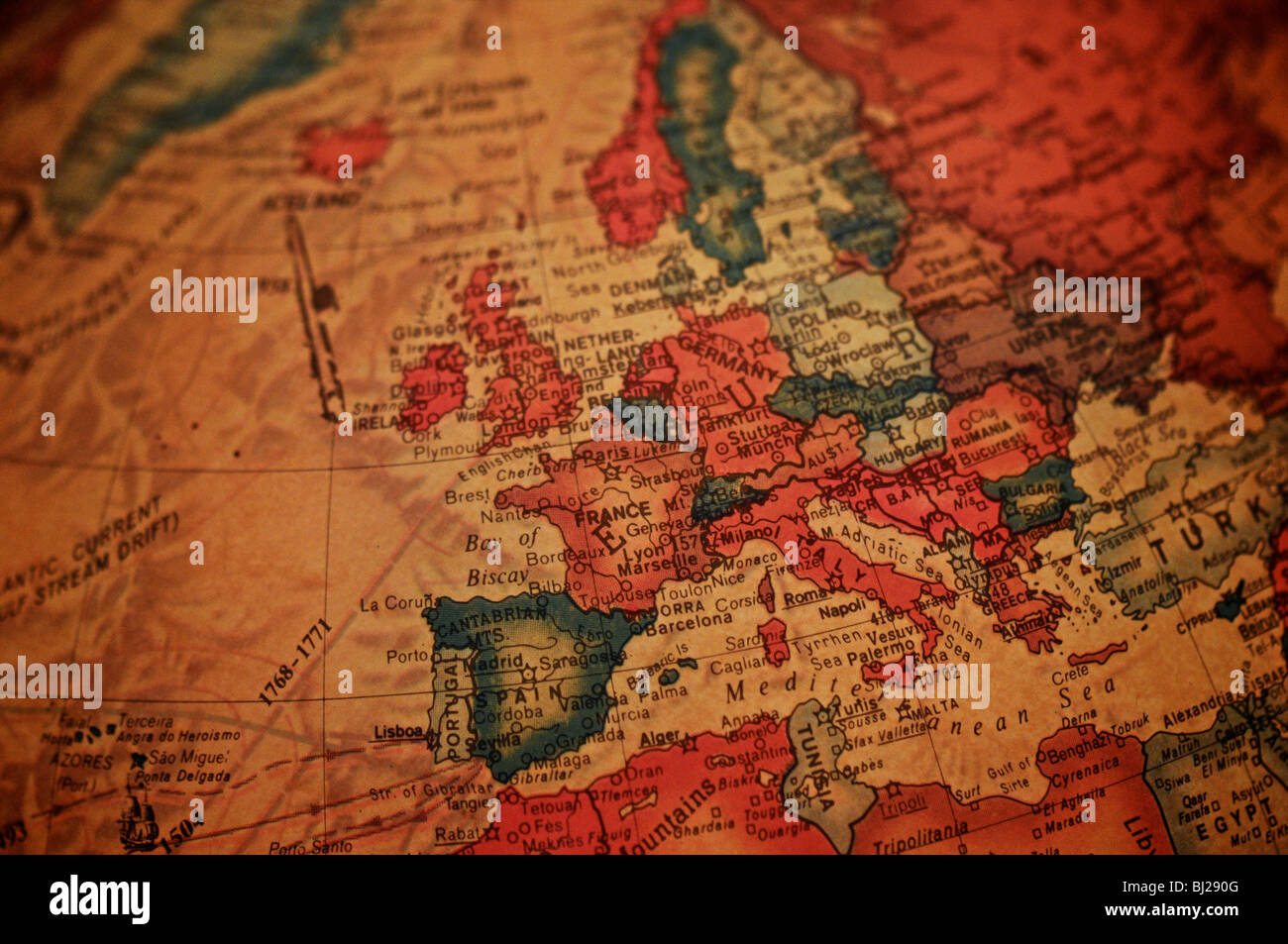 A detail photo of the world as depicted on an antique globe. Focusing on Europe. - Stock Image