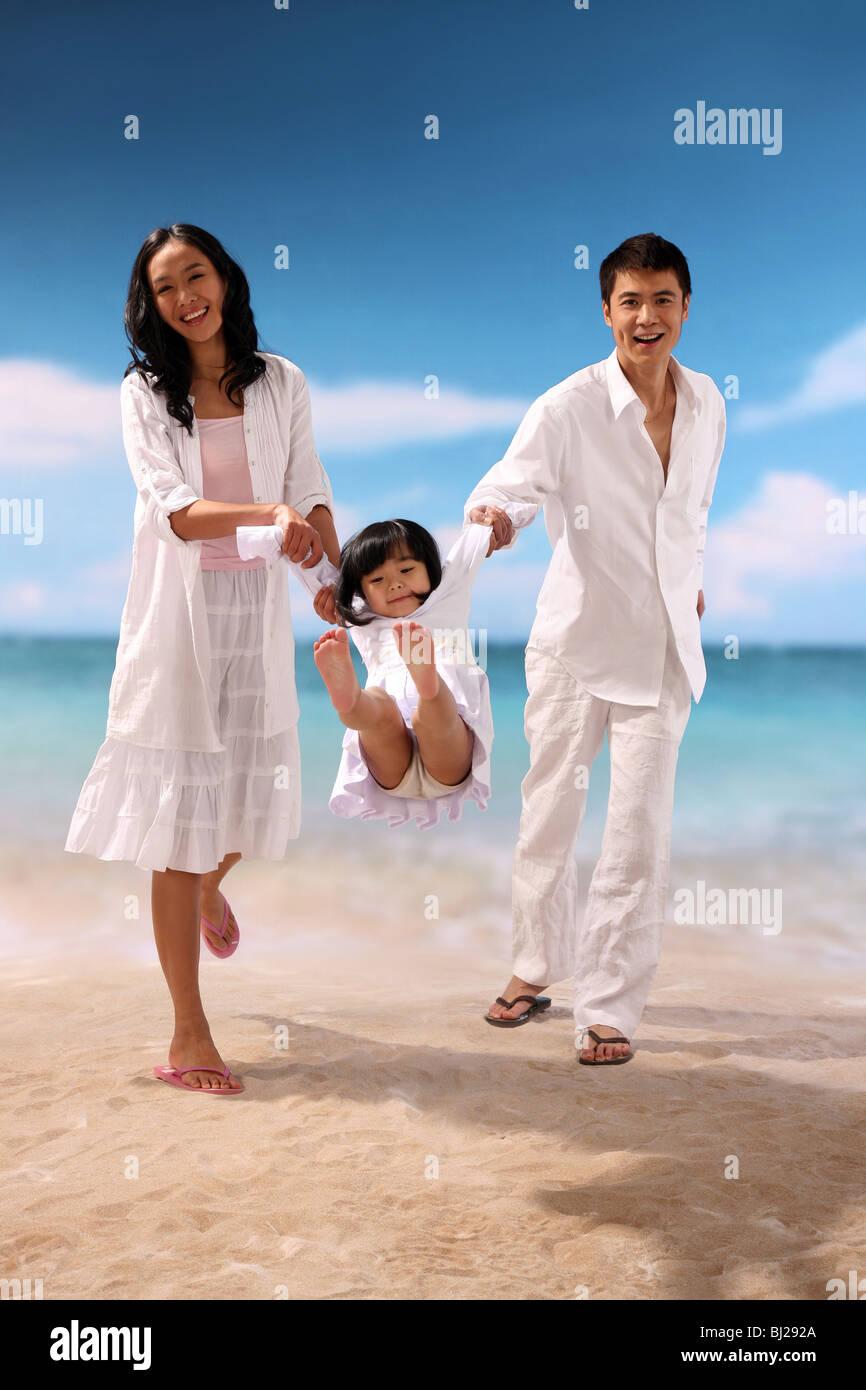 Portrait of family on beach - Stock Image
