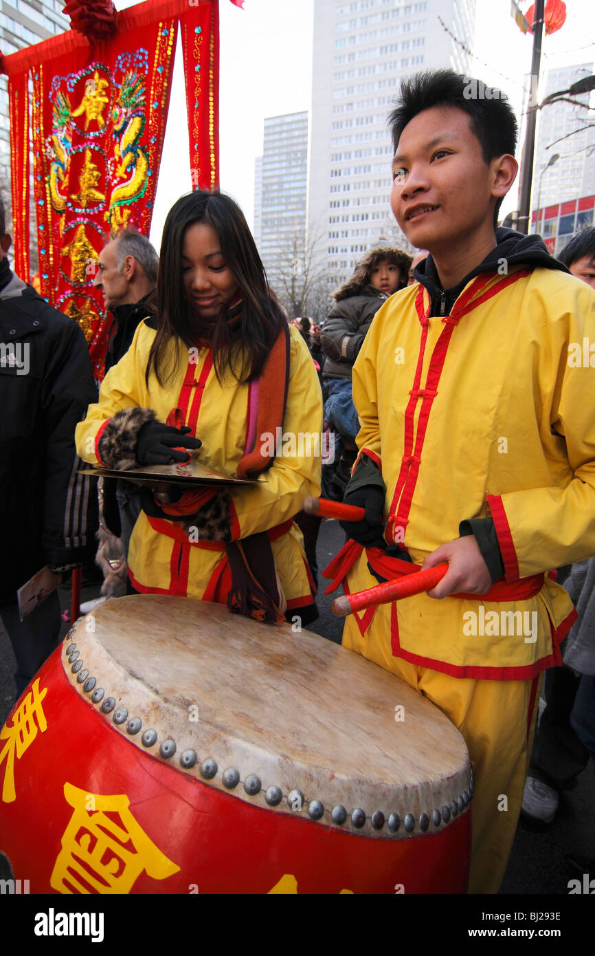 Young musicians performing at the Chinese New Year parade in the streets of Paris, France Stock Photo