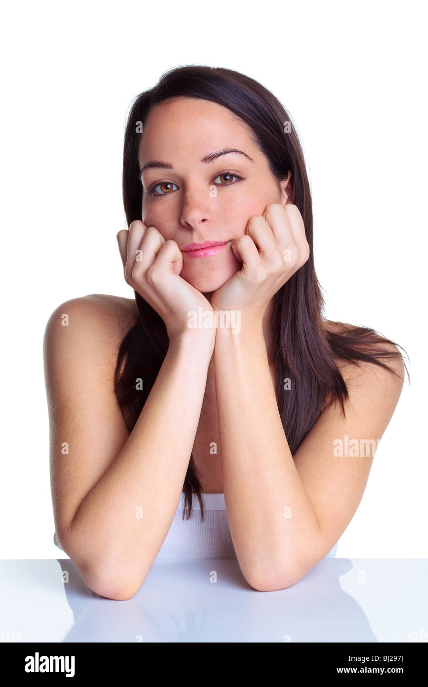 Brunette woman in her late twenties looking at camera - Stock Image