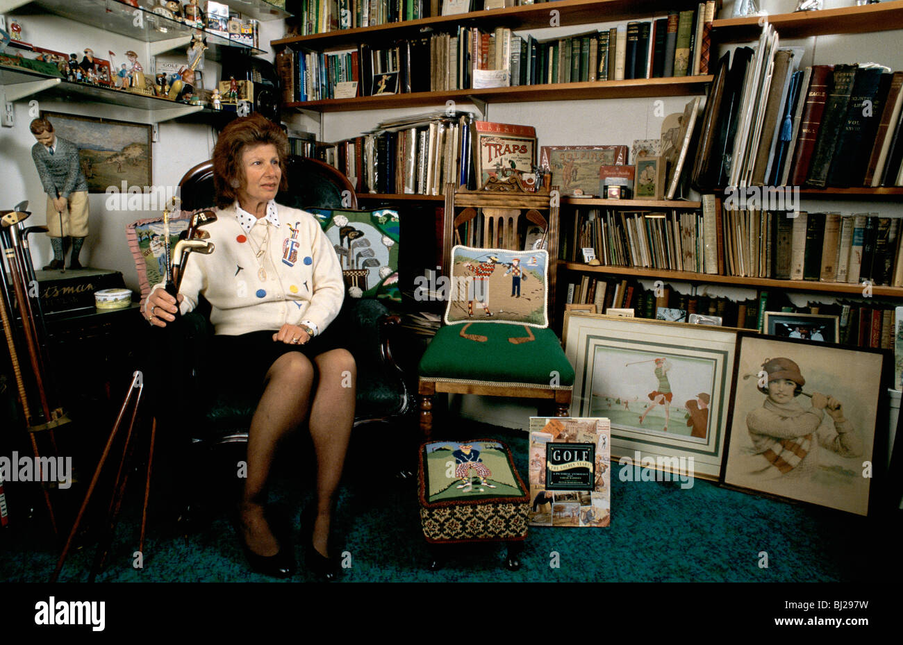 Author Sarah Fabian Baddiel at home with some of her golfing collection. - Stock Image