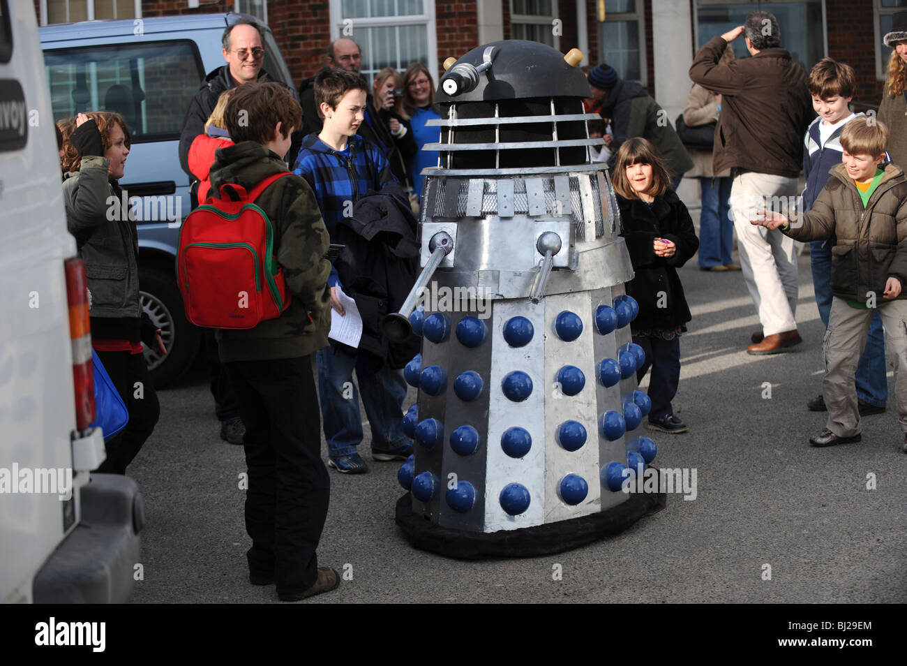 Children crowd round a life size darlek at the Brighton science festival - Stock Image