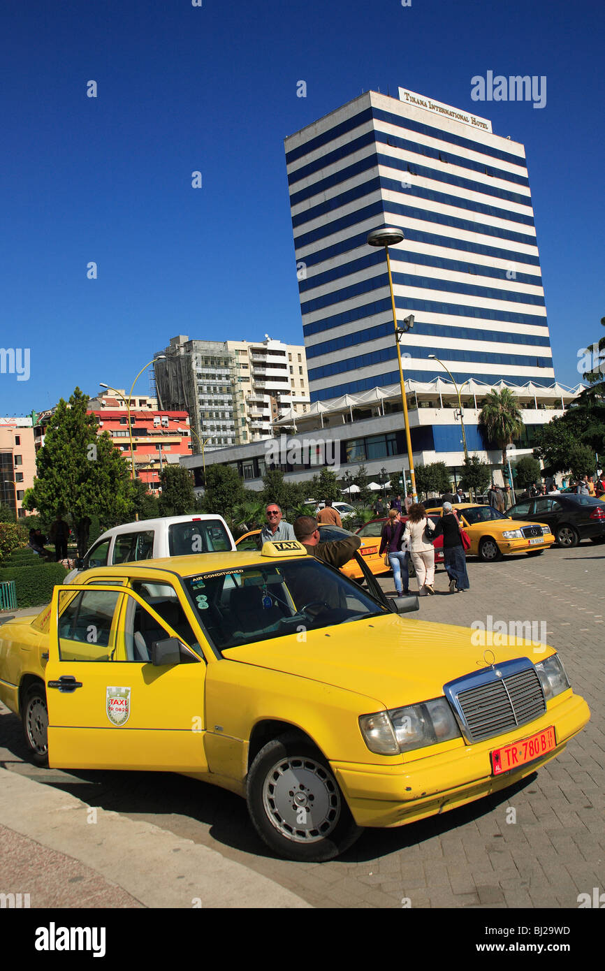 Taxi in front of the Tirana International Hotel, Tirana, Albania - Stock Image
