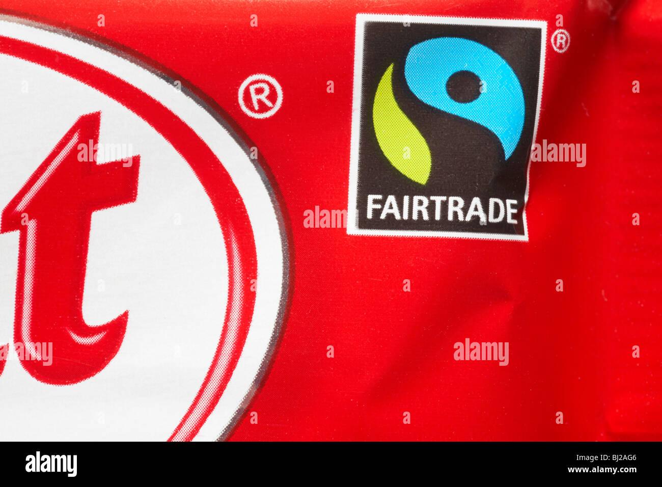 Fairtrade logo on KitKat chocolate bar wrapper - Fairtrade logo symbol Fair Trade - Stock Image