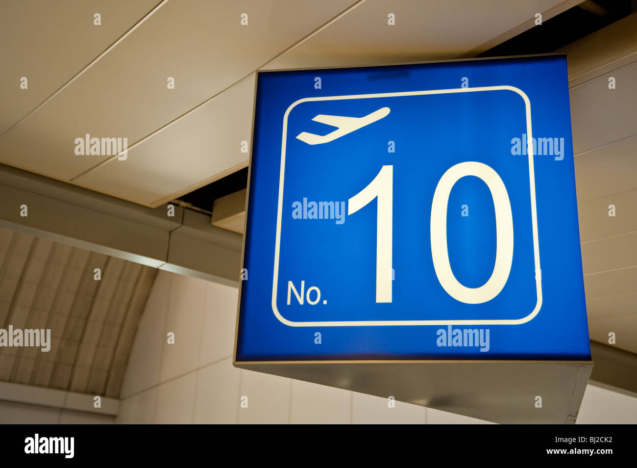The number 10 gate sigh at an airport - Stock Image